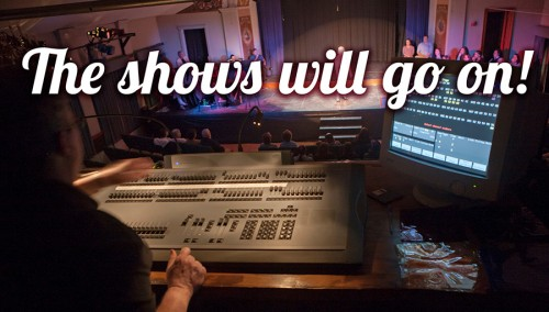 "Text: ""The shows will go on"" over photo of performer in spotlight as seen from lighting booth."